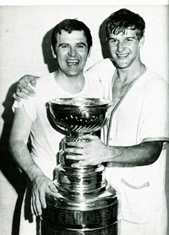 Orr Holding The Cup With Coach Harry Sinden