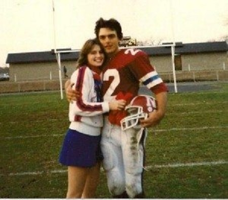 Laurie and her spouse Doug Flutie