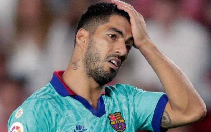 Suarez accused of cheating on Italian language test